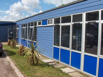Photograph of a commercial installation of Ocean Blue HardiePlank for a school in Wivenhoe