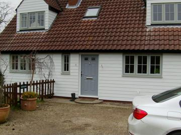 White HardiePlank on a property in Clavering with dormer windows
