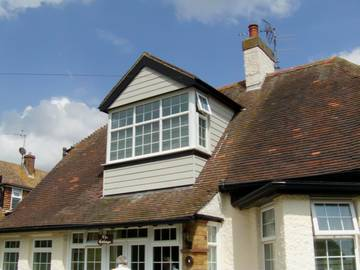 Photograph of Cobblestone HardiePlank cladding around a dormer in Clacton-on-Sea