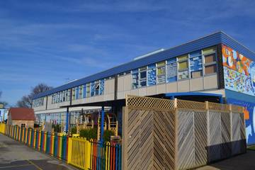 Photograph of an extensive Ocean Blue HardiePlank installation on a school in Walton-on-the-Naze