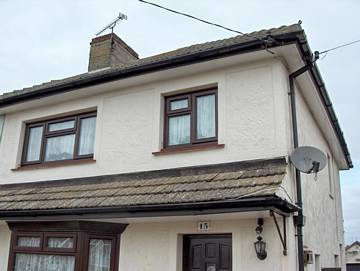 Photograph of a Black fascia with white soffit installation in Walton-on-the-Naze