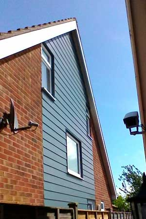 Photograph of a gable end cladding in Evening Blue HardiePlank in Walton-on-the-Naze, Essex