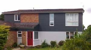 Photograph of Grey HardiePlank cladding the upper elevations of a house in Great Horkesley, Essex