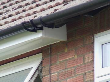 Photograph showing a box-in fascia and soffit in white PVC-u on a property in West Bergholt