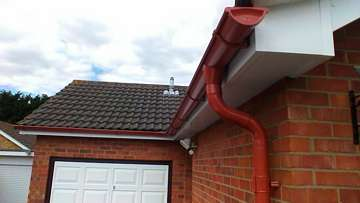 Tile REd Lindab rainwater goods on a bungalow in Clacton-on-Sea
